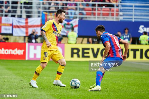 Lionel Messi of FC Barcelona Sergio Alvarez of Eibar during the La Liga SmartBank match between Eibar v FC Barcelona at the Estadio Municipal de...