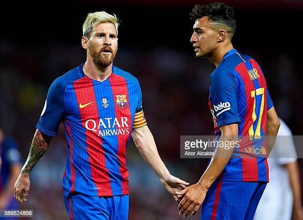 Lionel Messi of FC Barcelona shake hands with his team mate Munir El Haddadi of FC Barcelona during the match between Sevilla FC vs FC Barcelona as...
