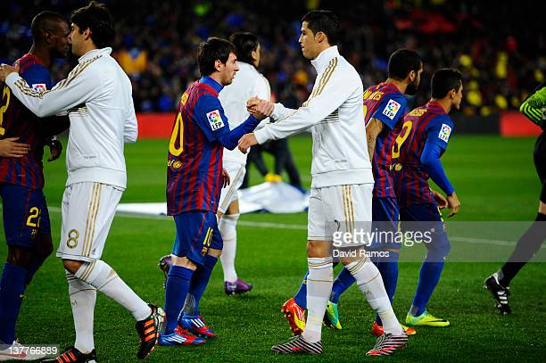 Lionel Messi of FC Barcelona shakes hands with Cristiano Ronaldo of Real Madrid prior to the Copa del Rey quarter final second leg match between FC...