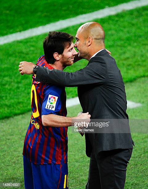 Lionel Messi of FC Barcelona shakes hands with his Head coach Josep Guardiola of FC Barcelona after scoring his team's third goal during the La Liga...