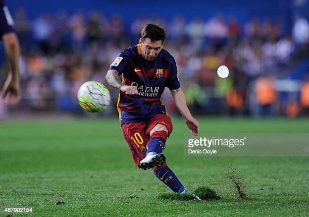 Lionel Messi of FC Barcelona shoots a free kick during the La Liga match between Club Atletico de Madrid and FC Barcelona at Vicente Calderon Stadium...