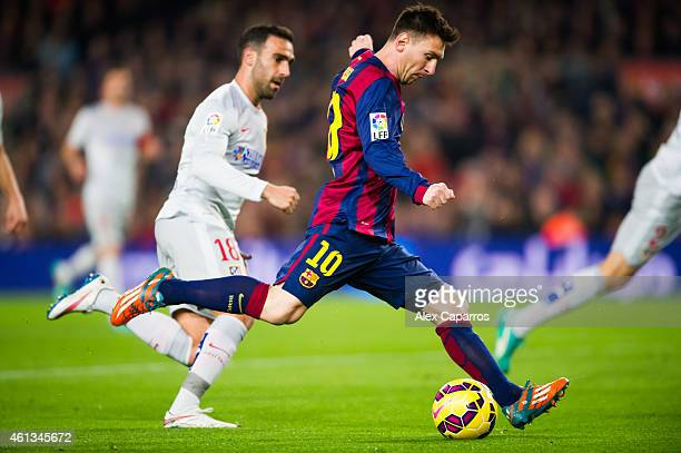 Lionel Messi of FC Barcelona shoots during the La Liga match between FC Barcelona and Club Atletico de Madrid at Camp Nou on January 11 2015 in...