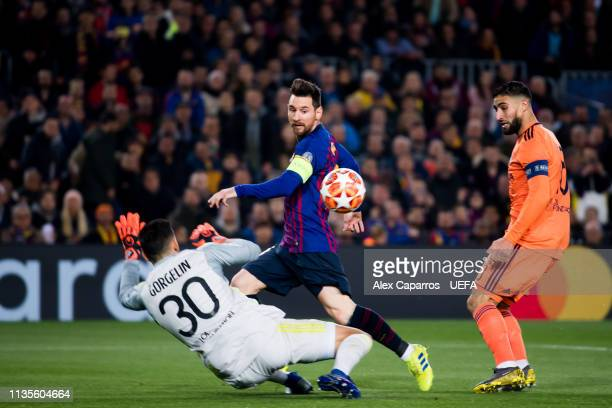 Lionel Messi of FC Barcelona shoots on target over goalkeeper Mathieu Gorgelin of Olympique Lyonnais during the UEFA Champions League Round of 16...