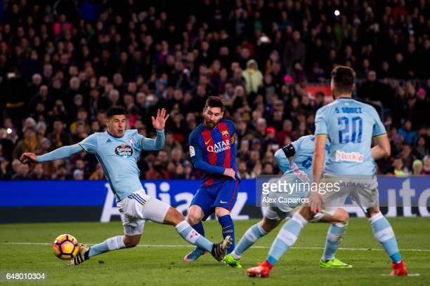 Lionel Messi of FC Barcelona shoots the ball and scores his team's fifth goal during the La Liga match between FC Barcelona and RC Celta de Vigo at...