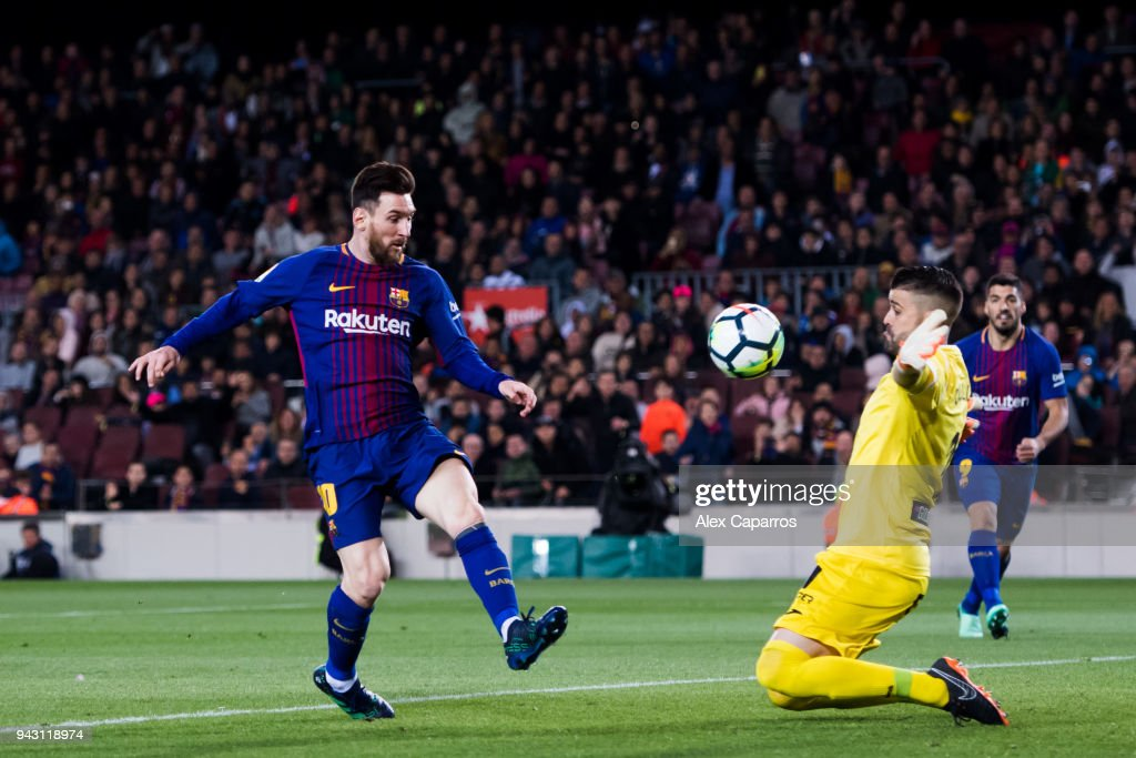 Lionel Messi of FC Barcelona shoots the ball over goalkeeper Ivan Cuellar of CD Leganes and scores his team's third goal during the La Liga match between Barcelona and Leganes at Camp Nou on April 7, 2018 in Barcelona, Spain.