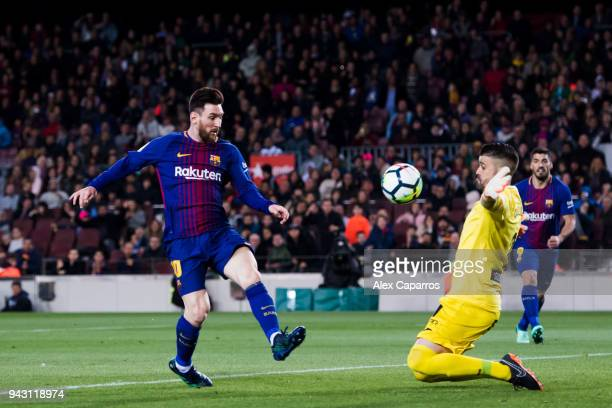 Lionel Messi of FC Barcelona shoots the ball over goalkeeper Ivan Cuellar of CD Leganes and scores his team's third goal during the La Liga match...