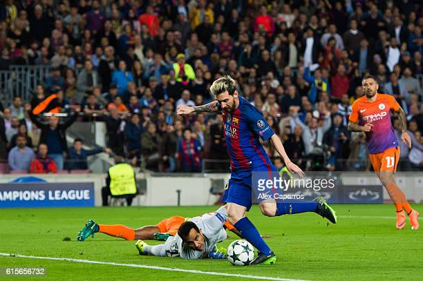 Lionel Messi of FC Barcelona shoots the ball past goalkeeper Claudio Bravo of Manchester City FC and scores the opening goal during the UEFA...