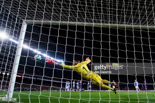 Lionel Messi of FC Barcelona shoots the ball past goalkeeper Ivan Cuellar of CD Leganes and scores the opening goal during the La Liga match between...