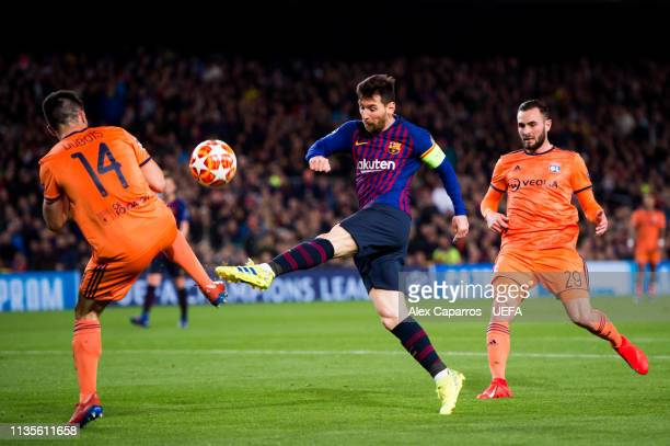 Lionel Messi of FC Barcelona shoots the ball under pressure from Leo Dubois of Olympique Lyonnais during the UEFA Champions League Round of 16 Second...