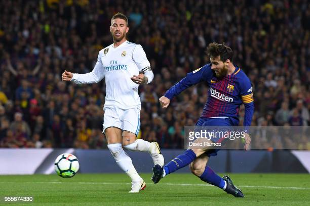Lionel Messi of FC Barcelona shoots towards goal during the La Liga match between Barcelona and Real Madrid at Camp Nou on May 6 2018 in Barcelona...