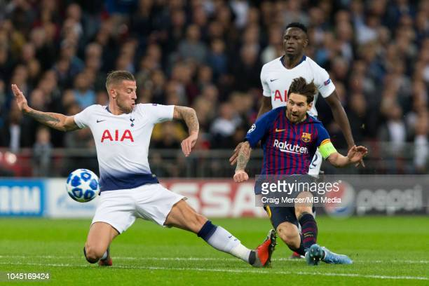 Lionel Messi of FC Barcelona shoots under pressure from Toby Alderweireld of Tottenham Hotspur during the Group B match of the UEFA Champions League...