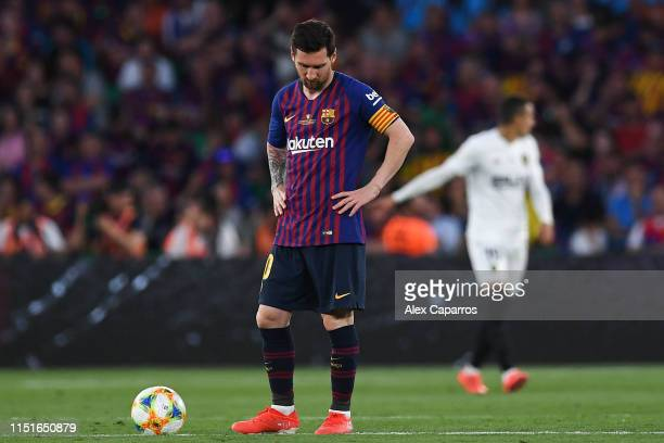 Lionel Messi of FC Barcelona shows his dejection after Rodrigo Moreno of Valencia CF scored his team's second goal during the Spanish Copa del Rey...