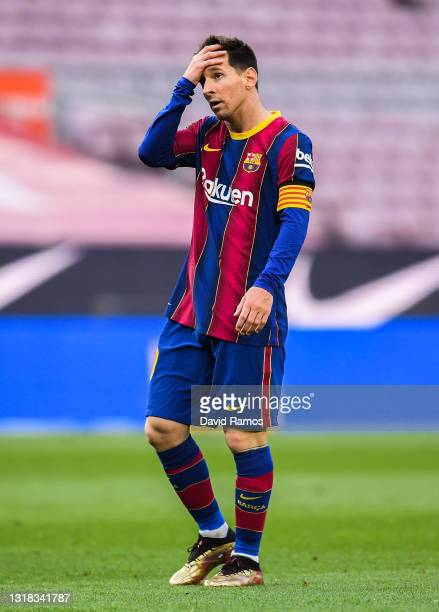 Lionel Messi of FC Barcelona shows his dejection during the La Liga Santander match between FC Barcelona and RC Celta at Camp Nou on May 16, 2021 in...