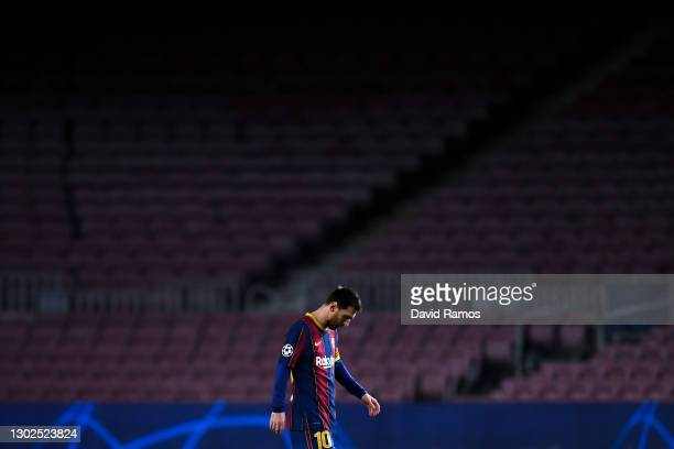 Lionel Messi of FC Barcelona shows his dejection during the UEFA Champions League Round of 16 match between FC Barcelona and Paris Saint-Germain at...