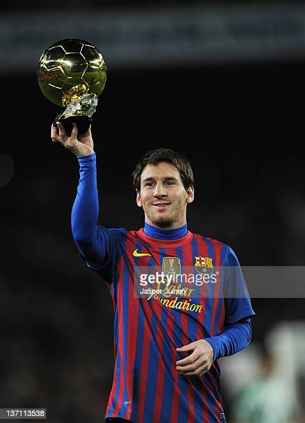 Lionel Messi of FC Barcelona shows the FIFA Ballon d'Or to the home crowd at the start of the la Liga match between FC Barcelona and Real Betis...