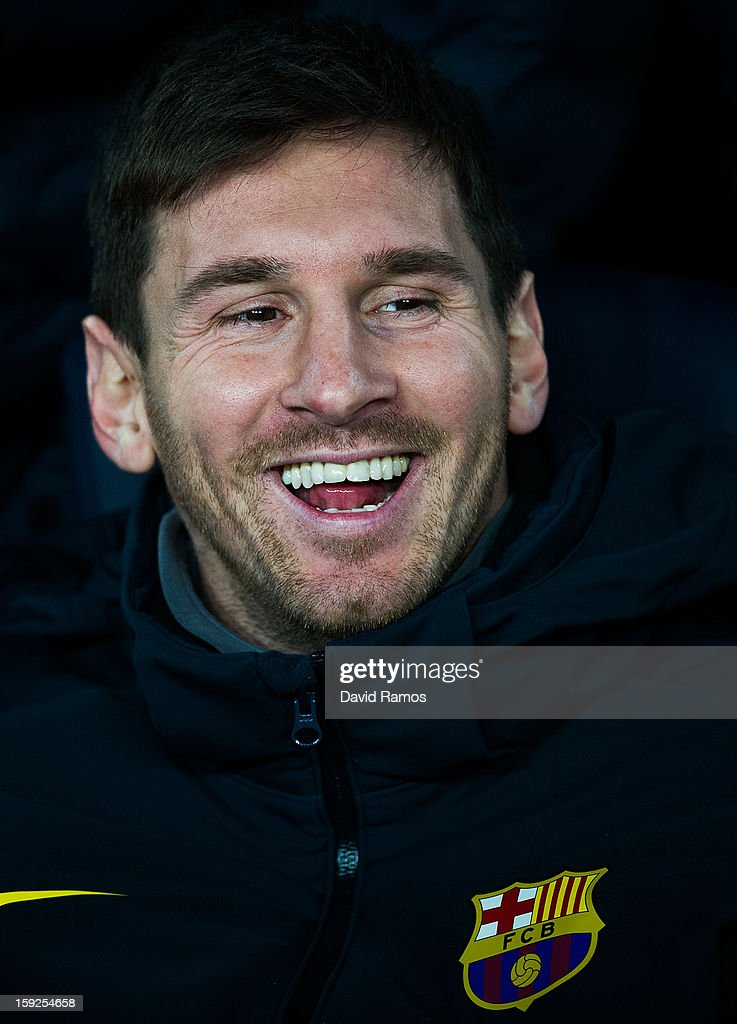 Lionel Messi of FC Barcelona smiles on the bench prior to the Copa del Rey round of sixteen second leg match between FC Barcelona and Cordoba CF at Camp Nou on January 10, 2013 in Barcelona, Spain.