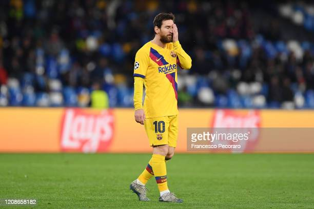 Lionel Messi of FC Barcelona stands disappointed during the UEFA Champions League round of 16 first leg match between SSC Napoli and FC Barcelona at...