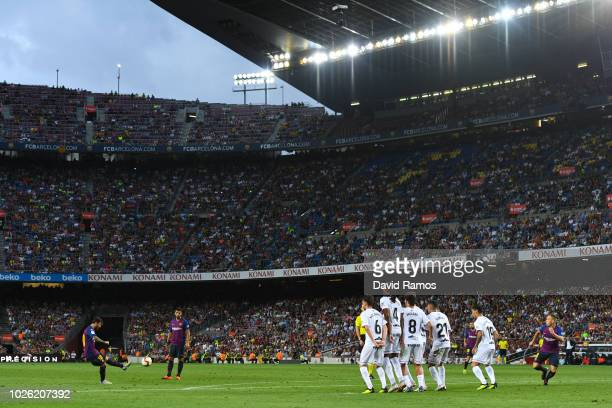 Lionel Messi of FC Barcelona takes a free kick during the La Liga match between FC Barcelona and SD Huesca at Camp Nou on September 2 2018 in...