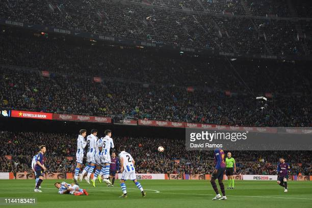 Lionel Messi of FC Barcelona takes a free kick during the La Liga match between FC Barcelona and Real Sociedad at Camp Nou on April 20 2019 in...