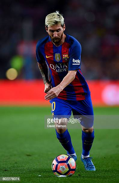 Lionel Messi of FC Barcelona takes a free kick during the La Liga match between FC Barcelona and Deportivo Alaves at Camp Nou stadium on September 10...