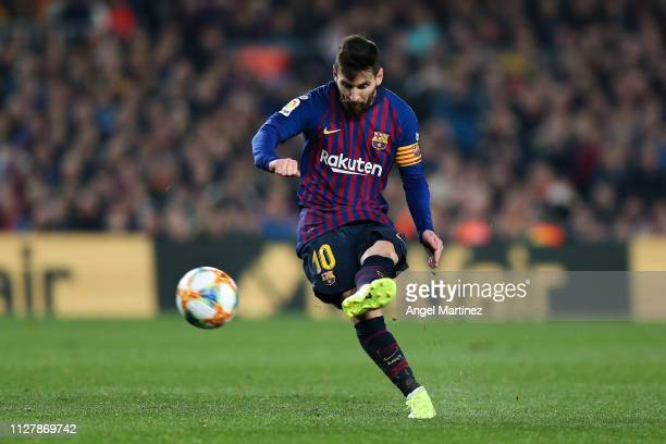 Lionel Messi of FC Barcelona takes a freekick during the Copa del Semi Final first leg match between Barcelona and Real Madrid at Nou Camp on...