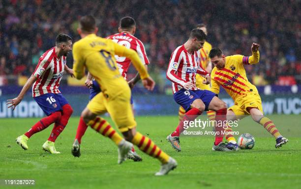 Lionel Messi of FC Barcelona takes on Alvaro Morata of Atletico Madrid during the Liga match between Club Atletico de Madrid and FC Barcelona at...