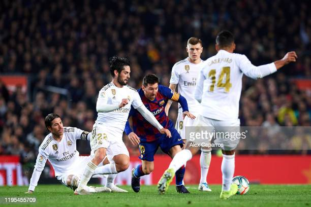 Lionel Messi of FC Barcelona tries to control the ball surrounded by Sergio Ramos, Francisco Alarcon 'Isco', Toni Kroos and Casemiro of Real Madrid...