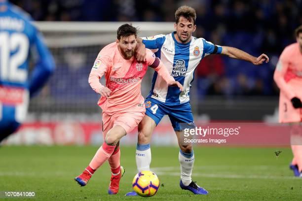 Lionel Messi of FC Barcelona V'ctor Sanchez of Espanyol during the La Liga Santander match between Espanyol v FC Barcelona at the RCDE Stadium on...
