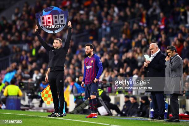 Lionel Messi of FC Barcelona waits to be brought on as a substitute during the UEFA Champions League Group B match between FC Barcelona and Tottenham...