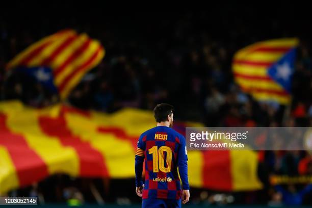 Lionel Messi of FC Barcelona walks for the pitch with a catalan independence flag in the background during the Copa del Rey round of 16 match between...