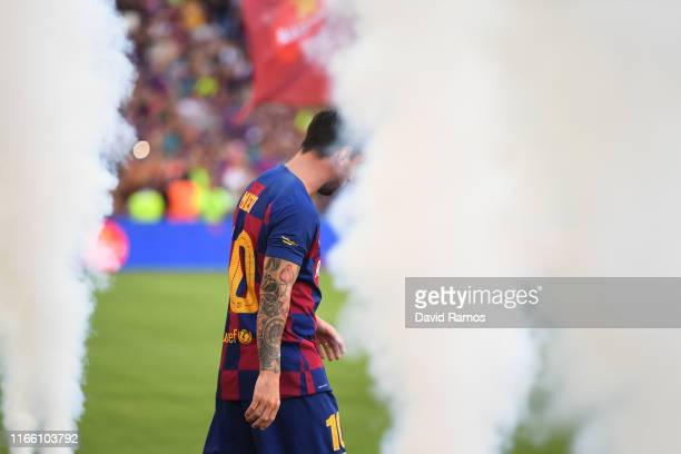 Lionel Messi of FC Barcelona walks onto pitch prior to the Joan Gamper trophy friendly match between FC Barcelona and Arsenal at Nou Camp on August...