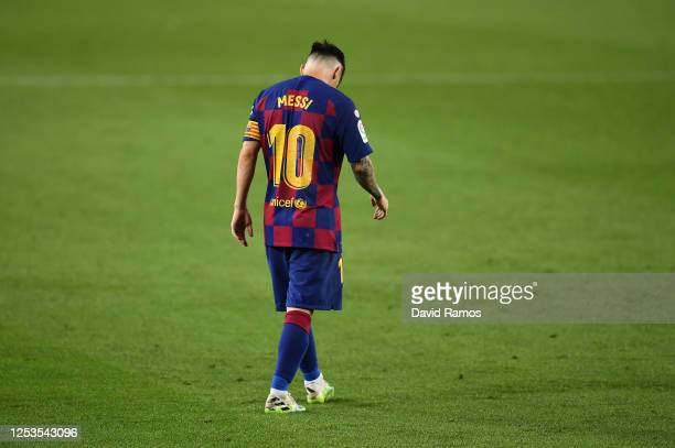 Lionel Messi of FC Barcelona walks over the pitch during the Liga match between FC Barcelona and Club Atletico de Madrid at Camp Nou on June 30 2020...