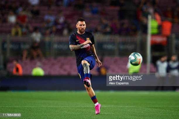 Lionel Messi of FC Barcelona warms up before the Liga match between FC Barcelona and Villarreal CF at Camp Nou on September 24, 2019 in Barcelona,...