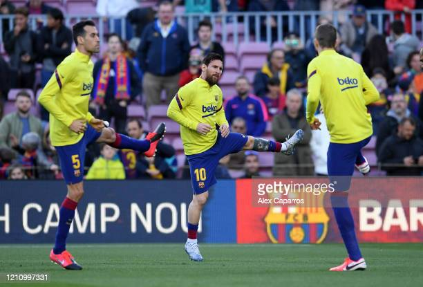 Lionel Messi of FC Barcelona warms up prior to the La Liga match between FC Barcelona and Real Sociedad at Camp Nou on March 07, 2020 in Barcelona,...