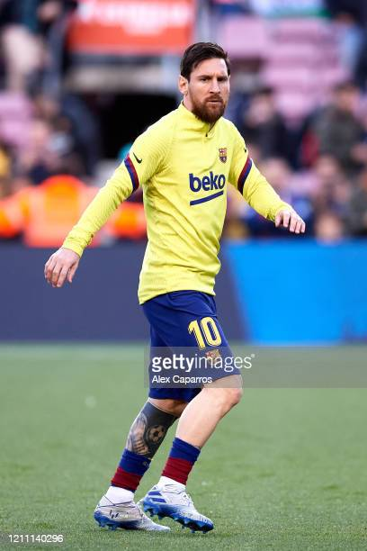 Lionel Messi of FC Barcelona warms up prior to the Liga match between FC Barcelona and Real Sociedad at Camp Nou on March 07 2020 in Barcelona Spain