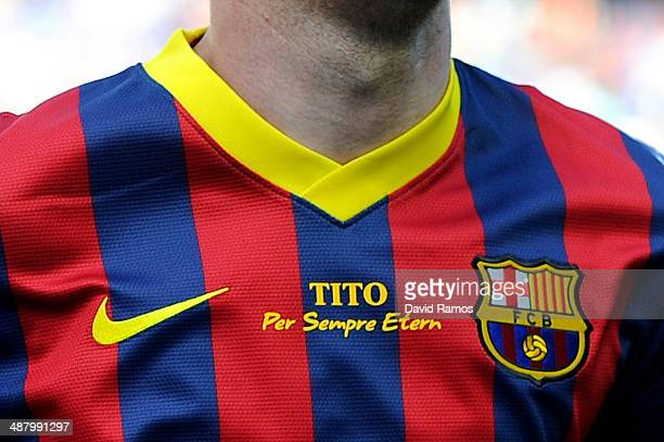 Lionel Messi of FC Barcelona wears a jersey displaying the message 'Tito forever eternal' in memory of former FC Barcelona head coach Tito Vilanova...