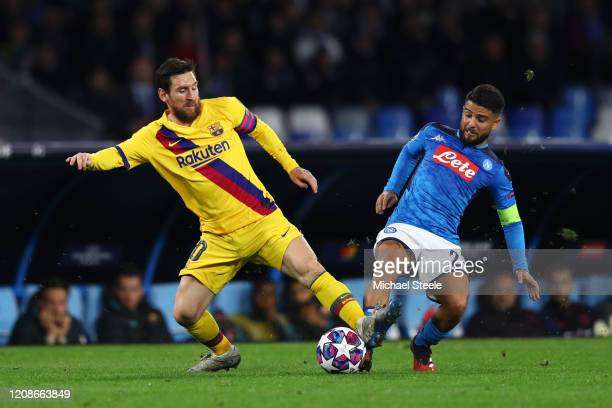 Lionel Messi of FC Barcelona wins the ball from Lorenzo Insigne of SSC Napoli during the UEFA Champions League round of 16 first leg match between...