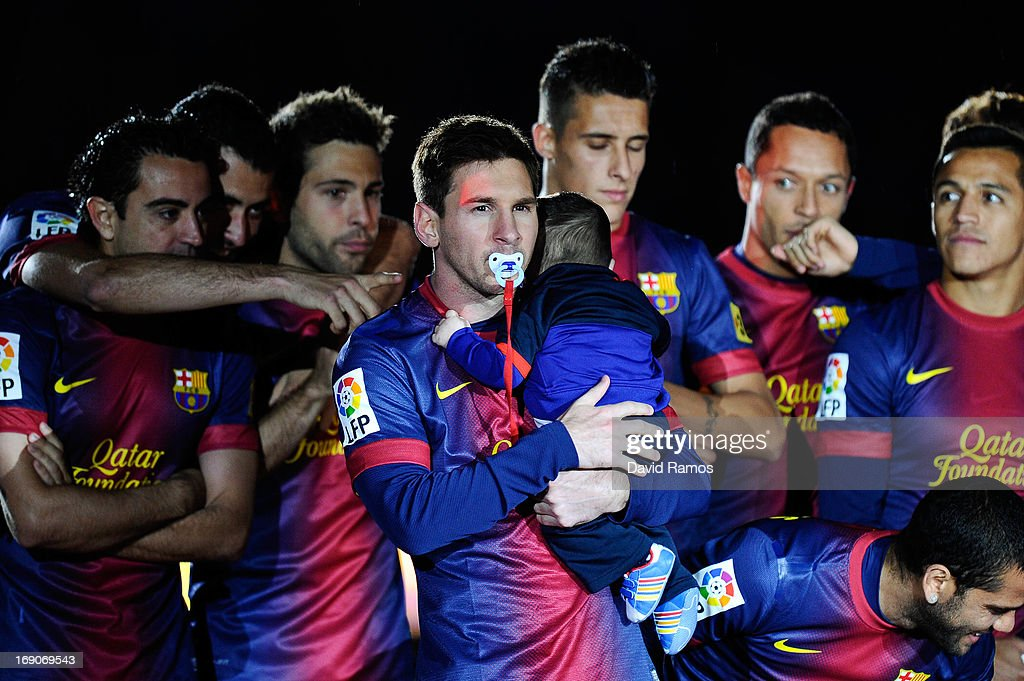 Lionel Messi of FC Barcelona with a dummy holds his son Thiago during the celebration after winning the Spanish League after the La Liga match between FC Barcelona and Real Valladolid CF at Camp Nou on May 19, 2013 in Barcelona, Spain.