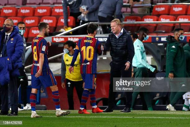 Lionel Messi of FC Barcelona with Ronald Koeman, Head Coach of FC Barcelona following the La Liga Santander match between FC Barcelona and Real Betis...