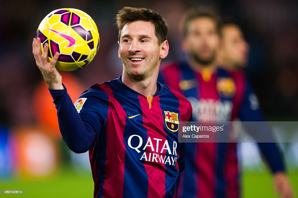 Lionel Messi of FC Barcelona with the match ball after scoring three goals during the La Liga match between FC Barcelona and RCD Espanyol at Camp Nou on December 7, 2014 in Barcelona, Spain.