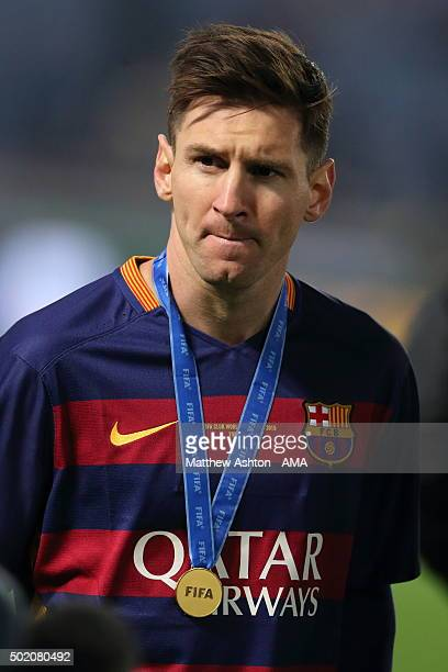 Lionel Messi of FC Barcelona with the winners medal around his neck during the FIFA Club World Cup Final Match between FC Barcelona and River Plate...