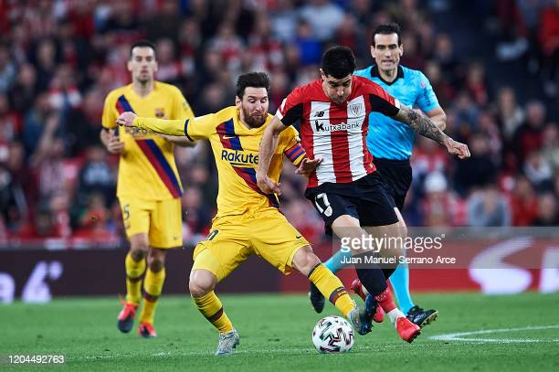 Lionel Messi of FC Barcelona Yuri Berchiche of Athletic Club during the Copa del Rey quarter final match between Athletic Bilbao and FC Barcelona at...