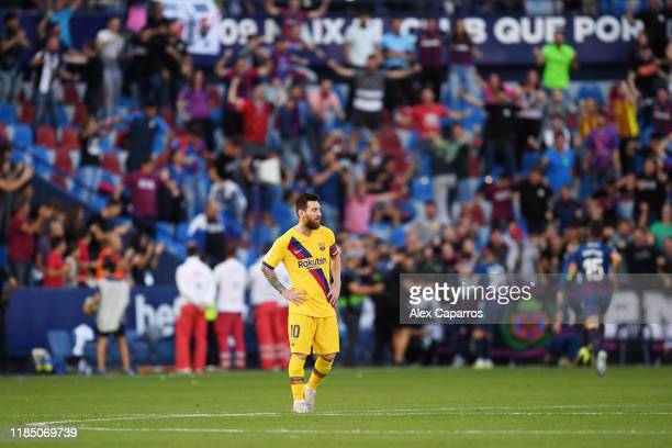 Lionel Messi of FC Barrcelona reacts after Levante's firs goal during the Liga match between Levante UD and FC Barcelona at Ciutat de Valencia on...