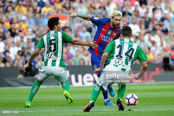 Lionel Messi of FCBarcelona fighting for the ball with Petros Matheus and Risa Durmisi from Real Betis during the Spanish League match between FC...