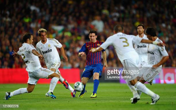 Lionel Messi of Messi of Barcelona is the centre of attention during the Super Cup second leg match between Barcelona and Real Madrid at Nou Camp on...