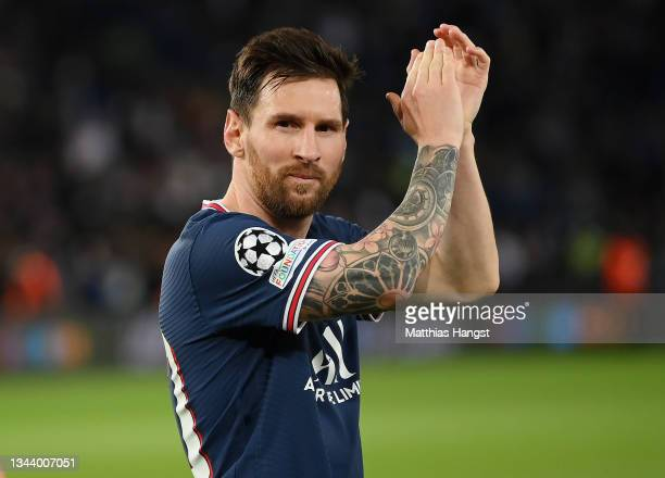 Lionel Messi of Paris Saint-Germain applauds the fans following victory in the UEFA Champions League group A match between Paris Saint-Germain and...