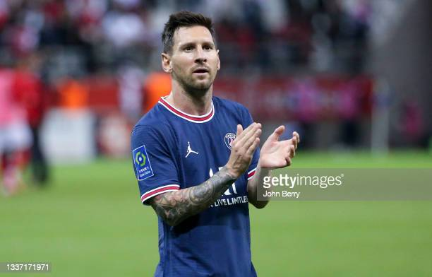 Lionel Messi of PSG salutes the supporters following the Ligue 1 Uber Eats match between Stade Reims and Paris Saint Germain at Stade Auguste Delaune...