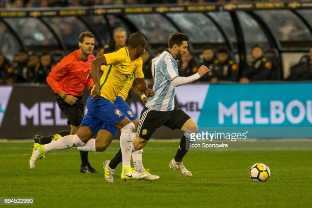 Lionel Messi of the Argentinan National Football Team and Fernando Roza of the Brazilian National Football Team contest the ball during the...