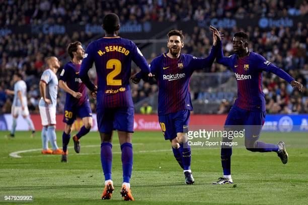 Lionel Messi Ousmane Dembele and Nelson Semedo of FC Barcelona celebrate the second goal during the La Liga match between Celta de Vigo and Barcelona...