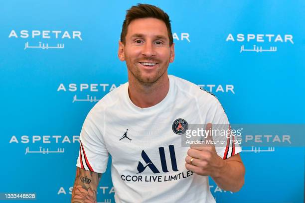 Lionel Messi poses before his medical tests ahead of signing for Paris Saint-Germain on August 10, 2021 in Paris, France.
